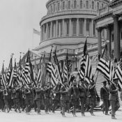 Veterans of World War I march in front of the U.S. capitol building demanding promised bonus payments for their service, in 1932.