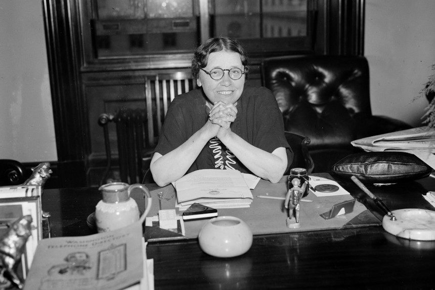 Hattie Wyatt Caraway behind her senate office's desk