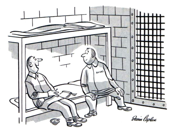 Two prisoners talking in a cell