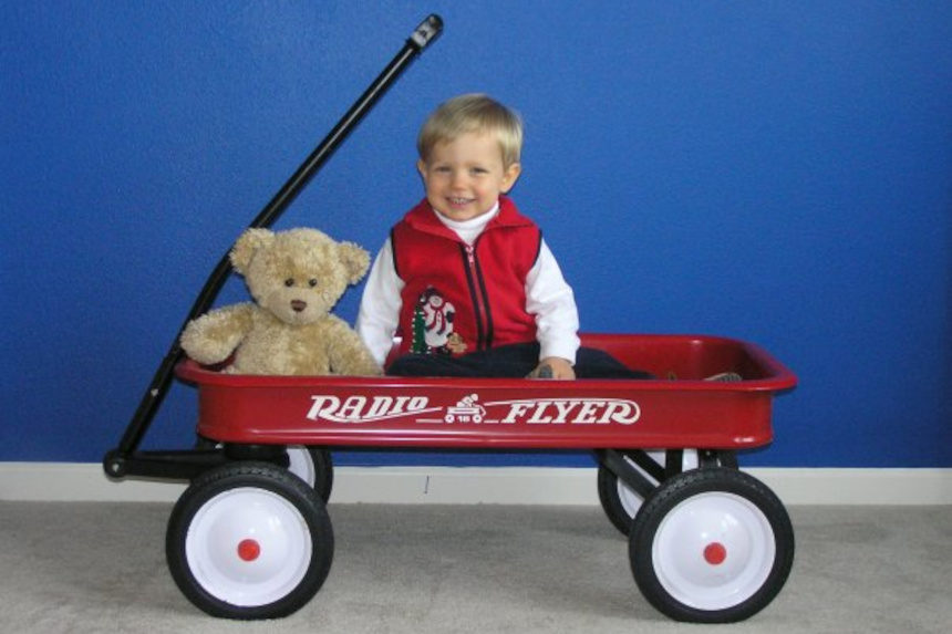 Troy Brownfield's son Conner in a Radio Flyer toy wagon