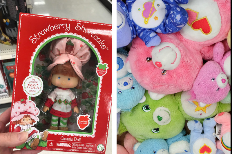 A strawberry shortcake doll and a pile of carebear dolls