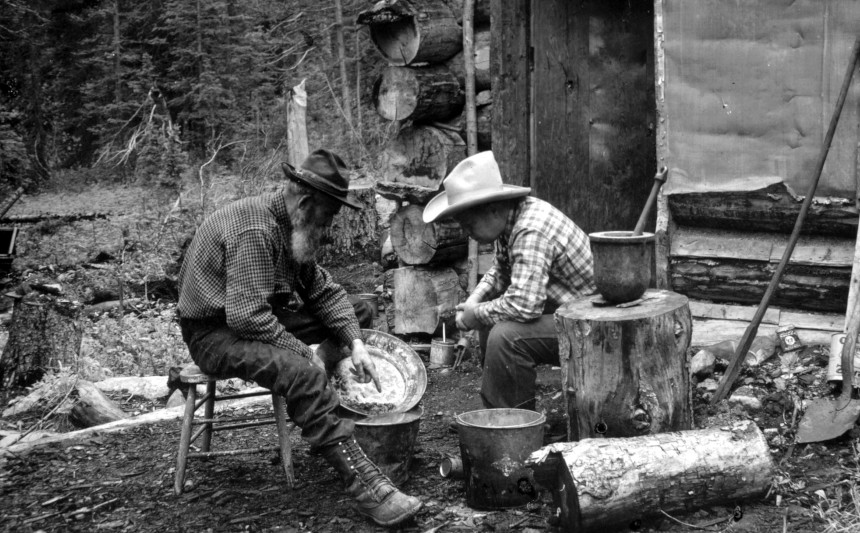 A pair of prospectors sorting through stones during the 1849 California Gold Rush