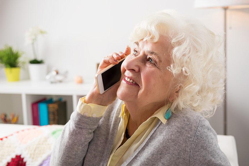 Older lady talking on a smart phone