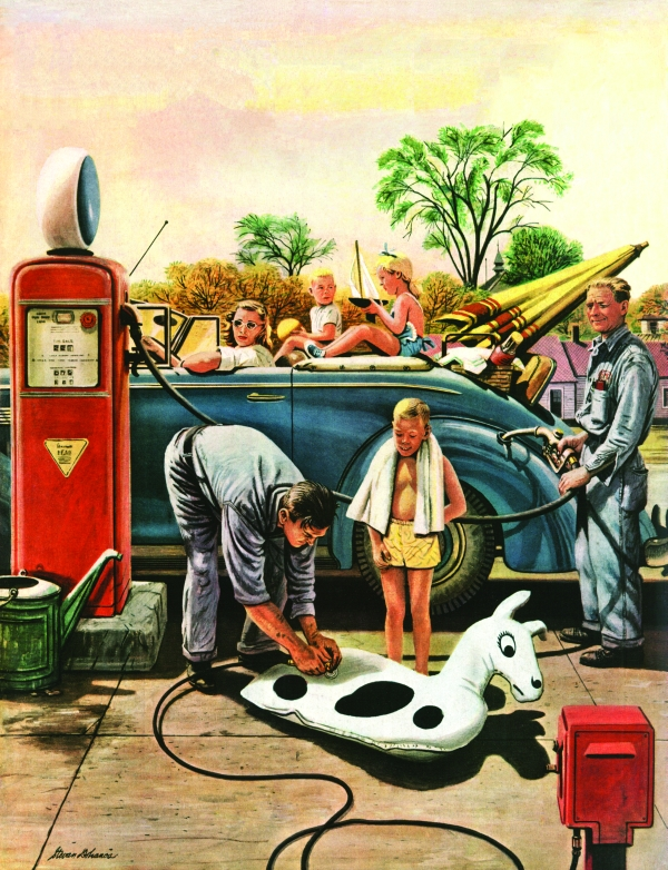 Boy waits as his father inflates his beach toy at a gas station.