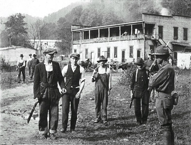 Miners surrendering their weapons to a federal soldier after the Battle of Blair Mountain, December 31, 1921 (https://libcom.org/gallery/battle-blair-mountain-1921-photo-gallery/ Wikimedia Commons, public domain)