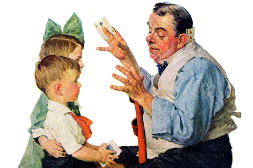 Magician performing card tricks to children