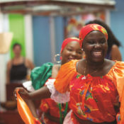 Female dancers in traditional Hattian dress perform in Miami's Little Haiti.