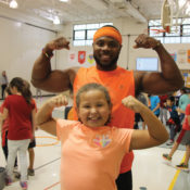 Darrion Crockwell flexes with one of his students during a PE class.