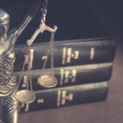 Statue of Justice and a stack of legal books