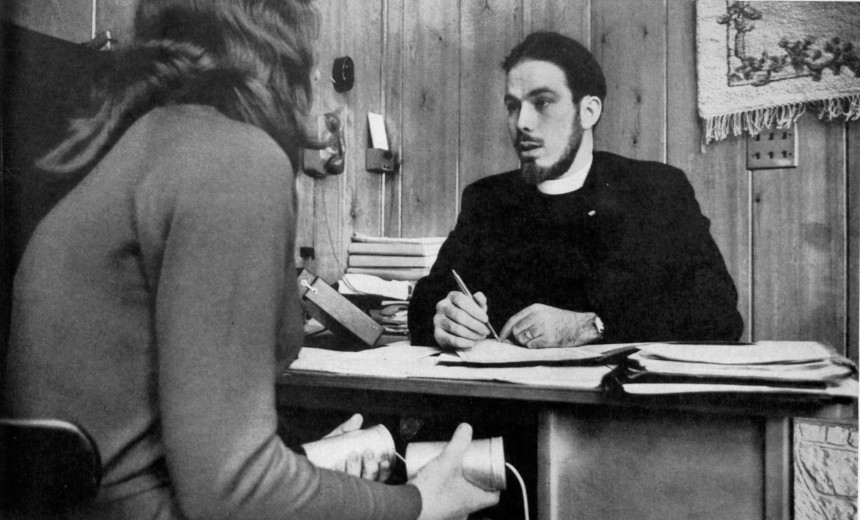 A student holds the infamous Scientology e-readers as she is being interviewed by one of their auditors.