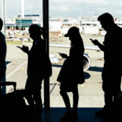 People lining up to board a plane at the London Heathrow airport