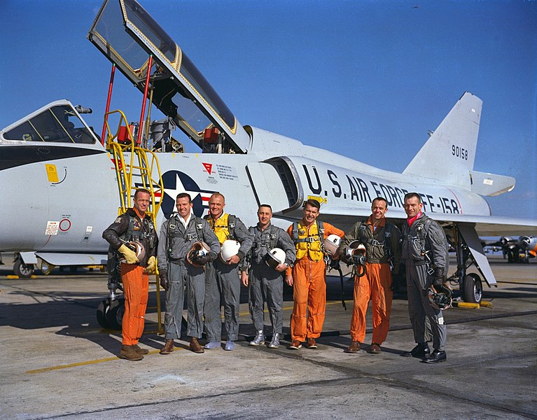 Members of the Mercury Seven with an Air Force fighter jet