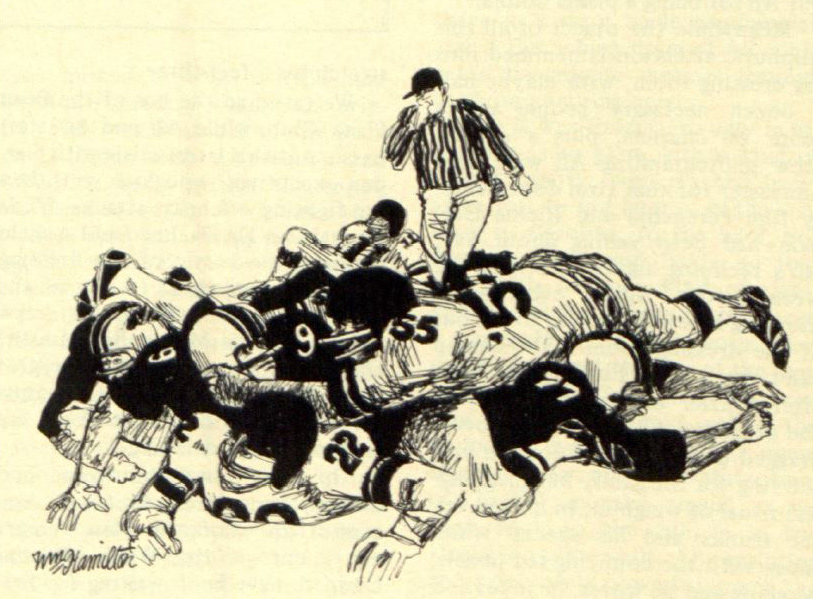 Two football players converse in a pile-up
