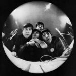 "At Miami Beach press conference, John Lennon, Ringo Starr, Paul McCartney, George Harrison bug a fisheye camera. ""Yeah! Yeah! Yeah! Music's Gold Bugs: The Beatles,"" The Saturday Evening Post. March 21, 1964."