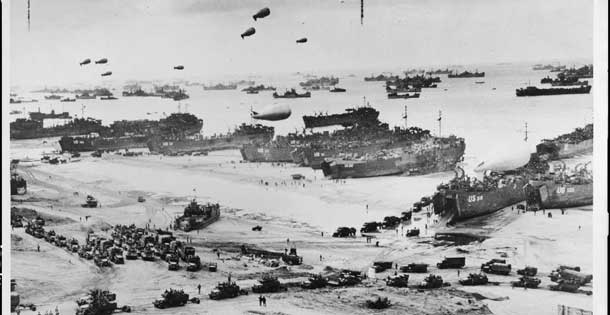 Landing craft, barrage balloons, and troops coming ashore at Normandy on D-Day, June 6, 1944. Source: Library of Congress