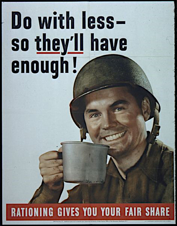 U.S. army G.I. smiling with a cup of coffee.