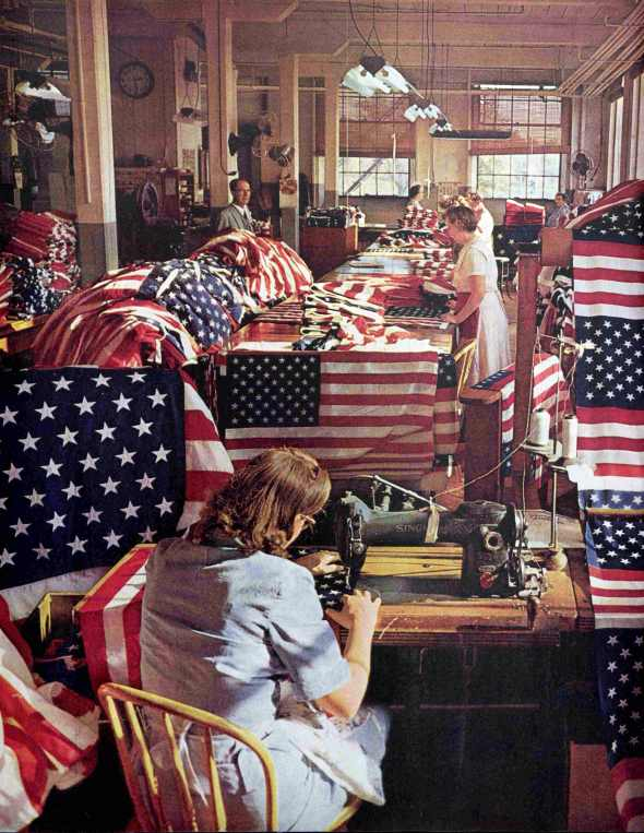 People Sewing 50 Stars on US Flag