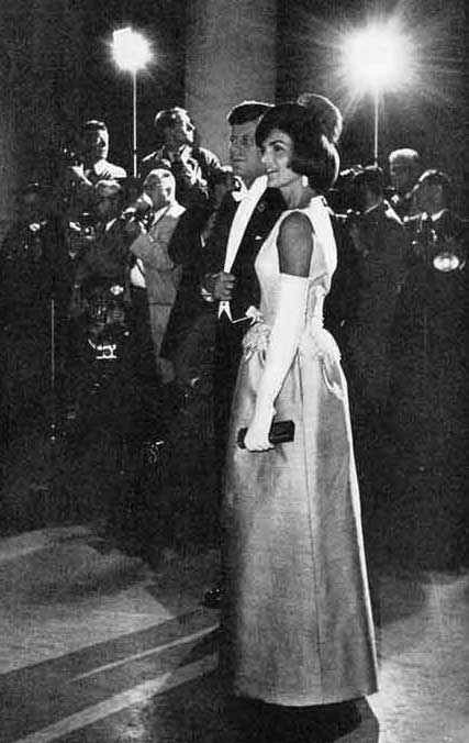 President John F. Kennedy and wife Jacqueline Kennedy at a White House soiree. © SEPS 2013