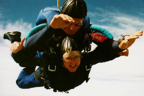 Linda (bottom) gives the camera a thumbs up as she and her instructor Pete (top) free fall from the plane. <br /> Photo taken by Skydive Miami.