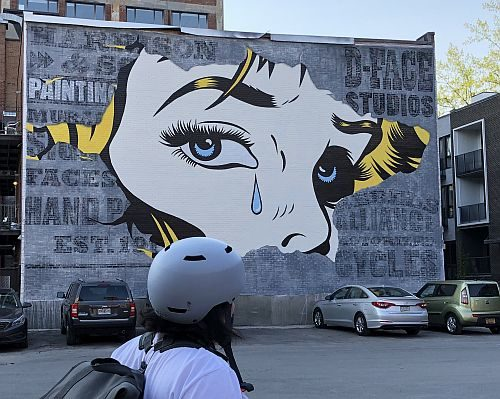 A mural of a woman's face.