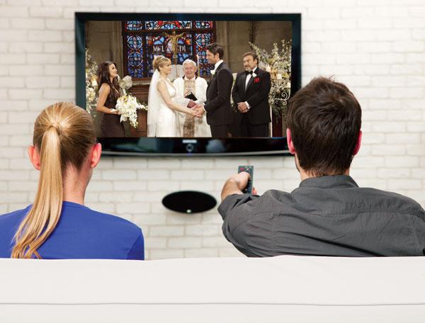 Couple watching HDTV