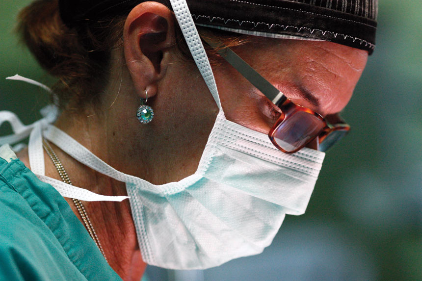 Closeup of Dr. Tammy Neblock-Beirne's face as she is performing surgery.