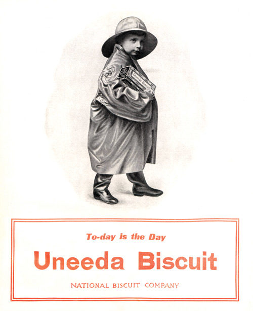 Ad for Unneda Biscuit. Boy in a raincoat.