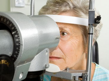 A woman having her eyes checked for Age-Related Macular Degeneration.
