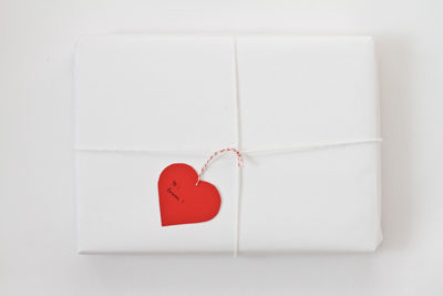 heart-shaped gift tag tied onto package