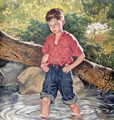 A boy wading through a stream.