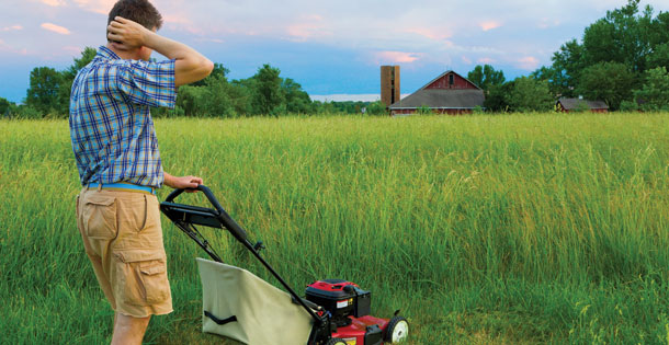A man mowing his lawn