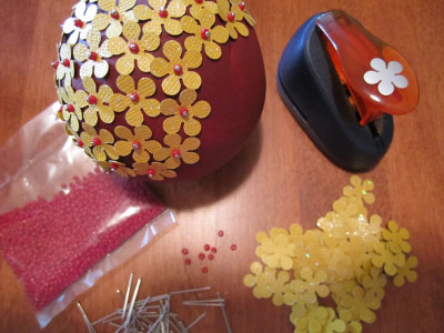 covering ball ornament with punch-flowers, beads, and pins