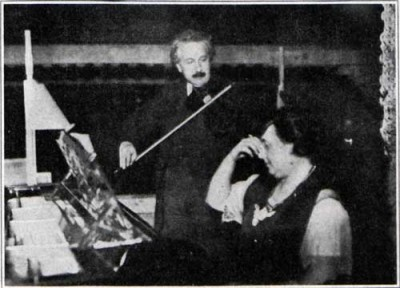 Doctor Einstein accompanying Mrs. Einstein's piano song with his violin.