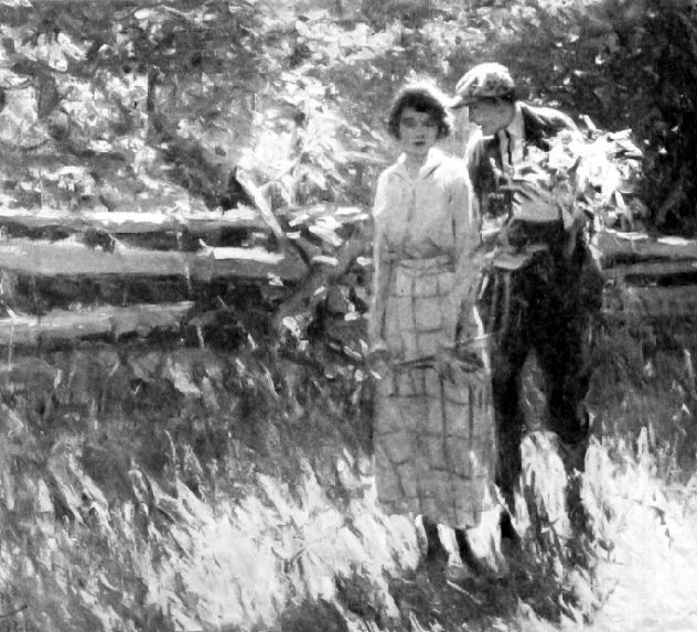 A young couple walking in a field